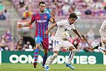 FC Barcelona's Sergio Busquets (l) and Getafe CF's Jose Juan Macias during La Liga match. August 29, 2021. (ALTERPHOTOS/Acero)