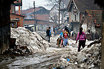 A snow-clogged street in the Krivac Roma Settlement in Smederevo, Serbia, one of the largest Roma neighborhoods in the Balkans. Many of the residents here arrived as refugees from Kosovo.
