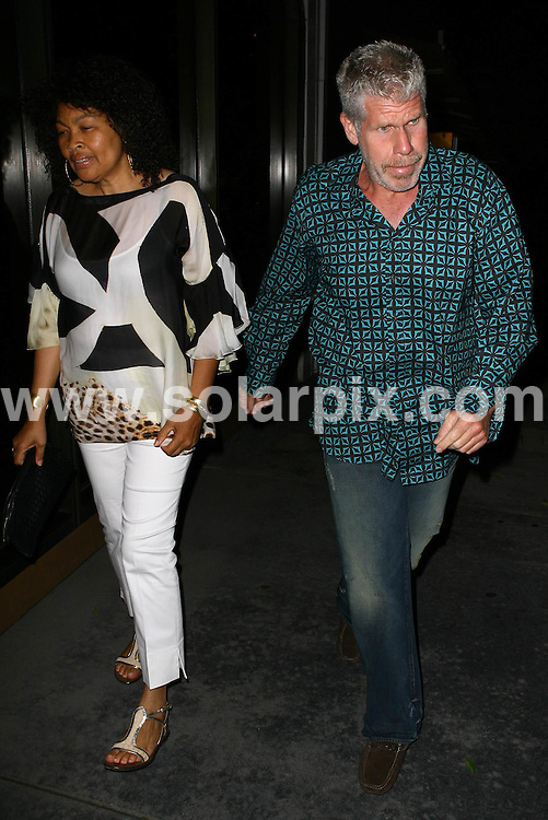 **ALL ROUND PICTURES FROM SOLARPIX.COM**.**WORLDWIDE SYNDICATION RIGHTS**.**NO PUBLICATION IN USA, DENMARK, GERMANY OR RUSSIA**.Ron Perlman and his girlfriend arriving at Madeo Restaurant in Beverly Hills for a late night dinner. Beverly Hills, Los Angeles, California, USA. 17th August 2008..This pic: Ron Perlman..JOB REF: 7053 LAP       DATE: 17_08_2008.**MUST CREDIT SOLARPIX.COM OR DOUBLE FEE WILL BE CHARGED* *UNDER NO CIRCUMSTANCES IS THIS IMAGE TO BE REPRODUCED FOR ANY ONLINE EDITION WITHOUT PRIOR PERMISSION*