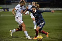 Lorient, France. - Sunday, February 8, 2015: Amel Majri (22) of France holds off Tobin Heath (17) of the USWNT. France defeated the USWNT 2-0 during an international friendly at the Stade du Moustoir