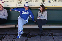 OAKLAND, CA - MAY 18:  Manager Ned Yost #3 of the Kansas City Royals talks with sports writer Susan Slusser of the San Francisco Chronicle before the game against the Oakland Athletics at O.co Coliseum on Saturday May 18, 2013 in Oakland, California. Photo by Brad Mangin
