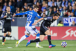 James Rodriguez (r) of Real Madrid fights for the ball with Ruben Perez of Deportivo Leganes during their La Liga match between Deportivo Leganes and Real Madrid at the Estadio Municipal Butarque on 05 April 2017 in Madrid, Spain. Photo by Diego Gonzalez Souto / Power Sport Images