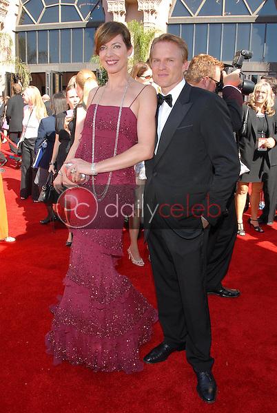 Allison Janney and friend<br />arriving at the 58th Annual Primetime Emmy Awards. The Shrine Auditorium, Los Angeles, CA. 08-27-06<br />Scott Kirkland/DailyCeleb.com 818-249-4998