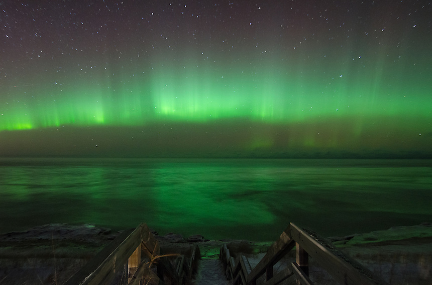 Bright Northern Lights dancing across the northern horizon and Lake Superior. Marquette, MI