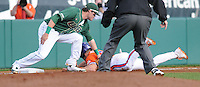 Designated hitter Phil Pohl (9) of the Clemson Tigers is tagged out trying to reach third base on a throwing error in a game against the University of Alabama-Birmingham on Feb. 17, 2012, at Doug Kingsmore Stadium in Clemson, South Carolina. UAB won 2-1. (Tom Priddy/Four Seam Images)