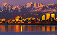 Anchorage cityscape with the Chugach mountains in the background at sunset. Anchorage, Alaska.