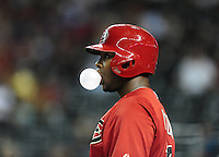 Apr. 3, 2012; Phoenix, AZ, USA; Arizona Diamondbacks outfielder Justin Upton blows a bubble as he stands in the on deck circle in the third inning against the Milwaukee Brewers during a spring training game at Chase Field.  Mandatory Credit: Mark J. Rebilas-