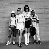 A multi-racial group of children posing in New Doornfontein. (L-R) Diane, Nadine, Bernadean and Benjamin.