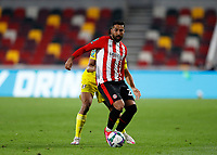 1st October 2020; Brentford Community Stadium, London, England; English Football League Cup, Carabao Cup Football, Brentford FC versus Fulham; Saman Ghoddos of Brentford holds off a challenge