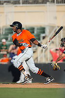 Gustavo Cabrera (19) of the Augusta GreenJackets follows through on his swing against the Kannapolis Intimidators at Intimidators Stadium on May 30, 2016 in Kannapolis, North Carolina.  The GreenJackets defeated the Intimidators 5-3.  (Brian Westerholt/Four Seam Images)