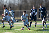 NWA Democrat-Gazette/CHARLIE KAIJO Springdale High School Irvin Sotero (19) dribbles during a soccer game, Friday, March 15, 2019 at Bentonville West in Centerton.