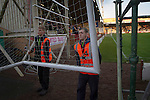 Motherwell 3 Dundee 1, 12/12/2015. Fir Park, Scottish Premiership. Ground staff carrying a set of practice goals from the pitch at Fir Park, home to Motherwell Football Club, before they played Dundee in a Scottish Premiership fixture. Formed in 1886, the  home side has played at Fir Park since 1895. Motherwell won the match by three goals to one, watched by a crowd of 3512 spectators. Photo by Colin McPherson.