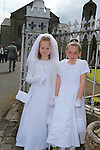 Lala Smith Emma Gibbs at first communion in Slane..Picture:  www.newsfile.ie ..