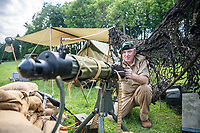 BNPS.co.uk (01202) 558833. <br /> Pic: MaxWillcock/BNPS<br /> <br /> Pictured: Gary Wise, in WWII desert uniform, with his Vickers machine gun. <br /> <br /> The Chalke Valley History Festival, the largest festival dedicated entirely to history in the UK, is taking place in Broadchalke near Salisbury, Wiltshire, from Wednesday 23 June - Sunday June 2021.<br /> <br /> This year, for the festival's tenth anniversary, the organisers are introducing a new Outdoor Programme that includes two outdoor stages, a revised Living History through-the-ages, and vintage fairground.