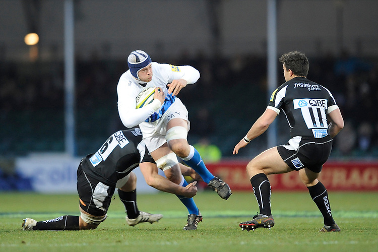 Dave Attwood of Bath Rugby (centre) is tackled by David Ewers of Exeter Chiefs (left as Jack Arnott looks on during the LV= Cup match between Exeter Chiefs and Bath Rugby at Sandy Park Stadium on Sunday 5th February 2012 (Photo by Rob Munro)