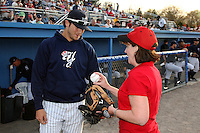 Congresswoman Kathy Hochul gets some advice from Empire State Yankees outfielder Ray Kruml #51 before throwing out the ceremonial first pitch before the first ever Triple-A International League game at Dwyer Stadium on April 20, 2012 in Batavia, New York.  Empire State defeated Norfolk 6-4.  (Mike Janes/Four Seam Images)