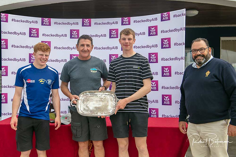 Royal Cork sailors Oisin MacSweeney (4.7) (left), Ed Walsh (standard) and Johnathan O'Shaughnessy (Radial) received the team prize from RCYC Admiral Colin Morehead (right) at the AIB Irish Laser Championships prizegiving