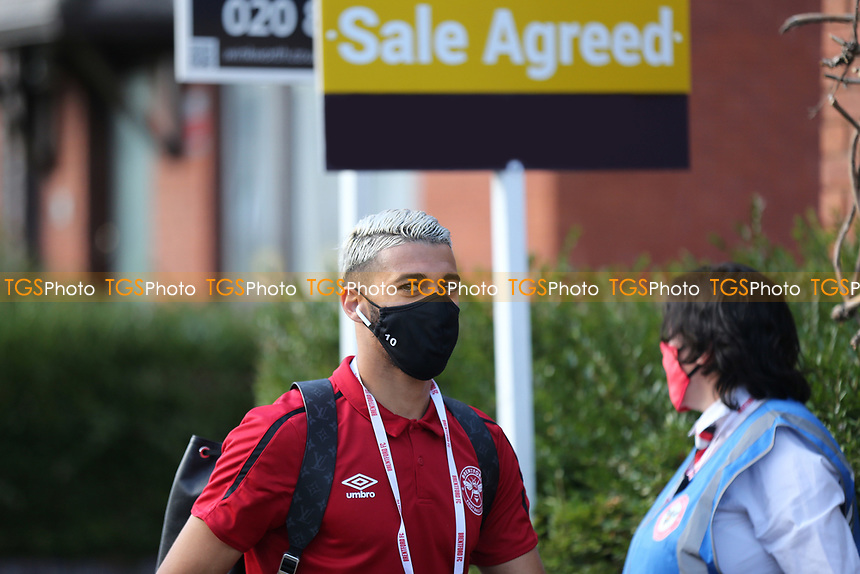 Said Benrahma of Brentford wearing a mask as he walks past a Sale Agreed sign on his way to the ground during Brentford vs Barnsley, Sky Bet EFL Championship Football at Griffin Park on 22nd July 2020