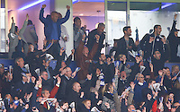 Jamie Vardy of Leicester City remains calm as supporters around him go wild after Leonardo Ulloa scores the second goal during the Barclays Premier League match between Leicester City and Swansea City played at The King Power Stadium, Leicester on 24th April 2016