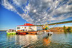 Float plane docked at a houseboat in Yellowknife Bay
