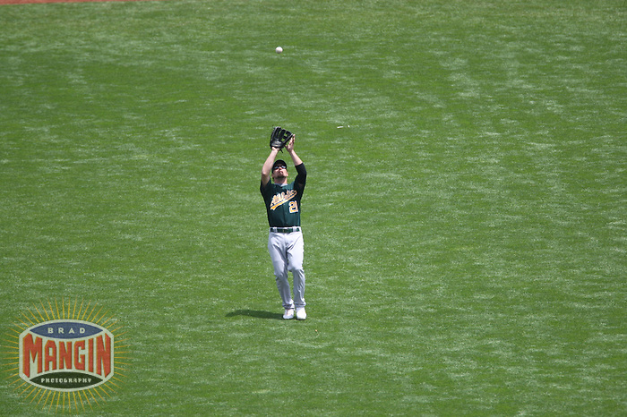 SAN FRANCISCO, CA - June 10:  Mark Kotsay of the Oakland Athletics catches a fly ball during the game against the San Francisco Giants at AT&T Park in San Francisco, California on June 10, 2007.  Photo by Brad Mangin