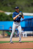 Lakeland Flying Tigers relief pitcher Evan Hill (32) set to deliver a pitch during a game against the Dunedin Blue Jays on May 27, 2018 at Dunedin Stadium in Dunedin, Florida.  Lakeland defeated Dunedin 2-1.  (Mike Janes/Four Seam Images)