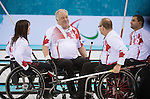 Sochi, RUSSIA - Mar 10 2014 -  Canada Wheelchair curling team discusses strategy between ends during Canada vs USA in Wheelchair Curling round robin play at the 2014 Paralympic Winter Games in Sochi, Russia.  (Photo: Matthew Murnaghan/Canadian Paralympic Committee)