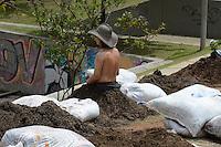 MEDELLÍN - COLOMBIA, 16-10-2014. Más de 18 personas, habitantes de la comuna 13 de Medellín, se sembraron simbólicamente en homenaje a las víctimas hoy, 16 octubre 2014, como un recordatorio de los 12 años de la operación Orion por parte del ejército en ese sector. La conmemoración tuvo como escenario el parque de la biblioteca de la comuna 13 como parte de la semana de la Memoria./ More than 18 people, residents of the Comuna 13 of Medellin, were sown themselves symbolically in tribute of the victims today, octobre 13 2014, as  a reminder of 12 years of the military operation Orion by the Colombian army in this area. The remembrance took place at Comuna 13 Library and is part of the Memory week.. Photo: VizzorImage/Luis Rios/STR