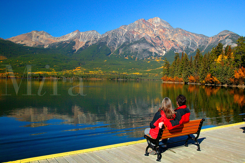 Visitors (MR) at Pyramid Lake viewing Pyramid Mountain, Jasper National Park, Alberta, Canada.  Model released.