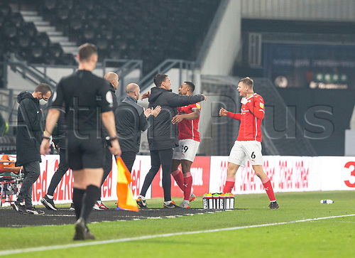 7th November 2020; Pride Park, Derby, East Midlands; English Football League Championship Football, Derby County versus Barnsley; Victor Adeboyejo of Barnsley celebrates with Barnsley Head Coach Valerien Ismael after scoring in the 83rd minute to take a 0-2 lead