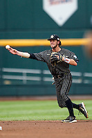 Vanderbilt Commodores shortstop Dansby Swanson (7) makes a throw to first base during the NCAA College baseball World Series against the Cal State Fullerton Titans on June 14, 2015 at TD Ameritrade Park in Omaha, Nebraska. The Titans were leading 3-0 in the bottom of the sixth inning when the game was suspended by rain. (Andrew Woolley/Four Seam Images)