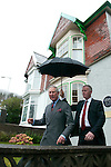 Prince Charles shelters from the heavy rain as he leaves the childhood home and birthplace of the famous Welsh poet Dylan Thomas this afternoon. The semi detached house in Cwmdonkin Drive in the Uplands district of Swansea (which the Prince toured) has been restored to how it would have been back in Dylan's day.