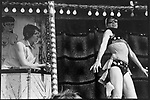 Striptease booth at the Derby Horse Race Epsom Downs. Surrey England 1969.<br /> <br /> This is direct from a vintage print. Negs and contacts are missing.