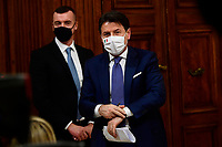 The Italian Prime Minister Giuseppe Conte and in the background his spokesman Rocco Casalino wearing face masks during the press conference about the Government decree containing measures to contrast Covid-19 emergency in Christmas time.  <br /> Rome (Italy), December 4th 2020<br /> Photo Pool Augusto Casasoli Insidefoto