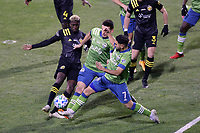 COLUMBUS, OH - DECEMBER 12: Cristian Roldan #7 of the Seattle Sounders FC beats Shane O'Neill #27 of the Seattle Sounders FC and Gyasi Zardes #11 of the Columbus Crew to a corner kick during a game between Seattle Sounders FC and Columbus Crew at MAPFRE Stadium on December 12, 2020 in Columbus, Ohio.