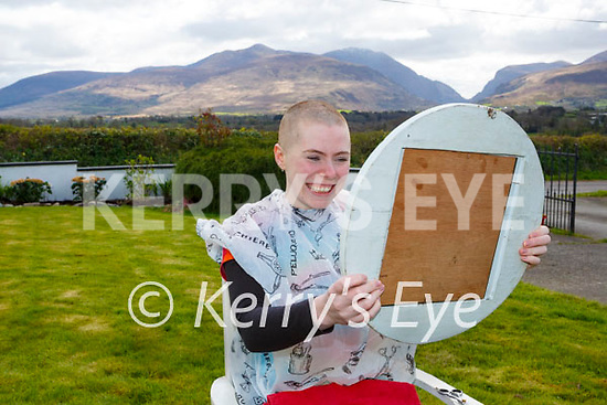 Laura Whelton Fossa looks in the mirror after  shaving her head  for the Kerry Rape Crisis Centre at her home on Tuesday