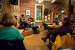 Mark Dudrow, left, and Roger Landes play to a full house at Bong Billy's. The cafe is one of the main sources of live music and good coffee in Salida, CO. Michael Brands for The New York Times.