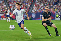 5th September 2021; Nashville, TN, USA;  United States forward Brenden Aaronson breaks away from Canada defender Scott Kennedy (23) during a CONCACAF World Cup qualifying match between the United States and Canada on September 5, 2021 at Nissan Stadium in Nashville, TN.
