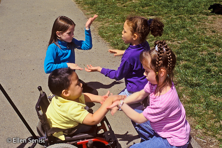 MR / Schenectady, NY.Zoller Public School / Grade 1 Inclusion Class.Recess: students play hand game outside. Boy in wheelchair: 7, spina bifida, sacral agenesis, Bangledeshi & Puerto Rican-American..MR: SNB.PN#:30060                        FC#:21651-01009.scan from slide.©Ellen B. Senisi