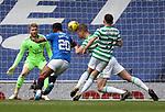 02.05.2121 Rangers v Celtic: Kris Ajer heads clear from Alfredo Morelos
