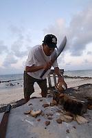 Chopping coconuts, Comarca De Kuna Yala, San Blas Islands, Panama