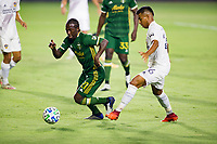 CARSON, CA - OCTOBER 07: Diego Chara #21 of the Portland Timbers moves past Efrain Alvarez #26 of the Los Angeles Galaxy with the ball during a game between Portland Timbers and Los Angeles Galaxy at Dignity Heath Sports Park on October 07, 2020 in Carson, California.