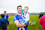 Bryan Sheehan celebrates with Donagh after their South Kerry Championship Final win on Sunday.
