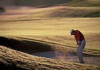 5TH HOLE, BLACK DIAMOND RANCH. MAN HITTING BALL OUT OF SAND TRAP, ROLLING HILLS WITH GOLDEN SUN IN BACKGROUND, SPORTS, GOLF, GOLFING. TERRANCE LAGREE. LECANTO FLORIDA, BLACK DIAMOND RANCH.