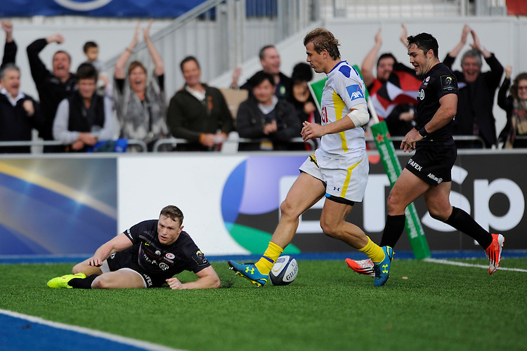 Chris Ashton of Saracens runs in a try during the European Rugby Champions Cup  Round 1 match between Saracens and ASM Clermont Auvergne at the Twickenham Stoop on Saturday 18th October 2014 (Photo by Rob Munro)