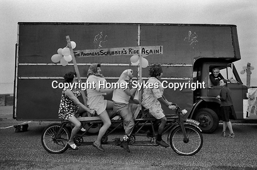 Isle of Man, Peel annual carnival 1970s. Group of men dressing up in women's clothes for a bit of fun. 1978