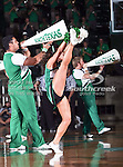 A North Texas Mean Green cheerleader does a high kick during the NCAA Women's basketball game between the Arkansas State Red Wolves and the University of North Texas Mean Green at the North Texas Coliseum,the Super Pit, in Denton, Texas. Arkansas State defeated UNT 62 to 59