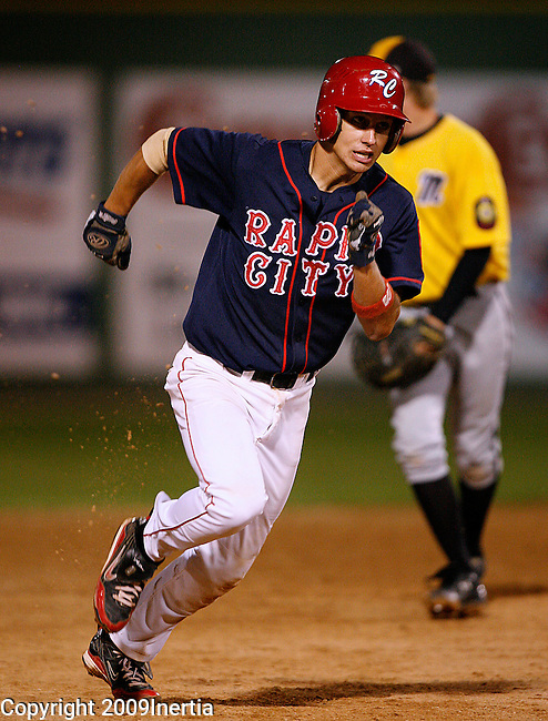 RAPID CITY, SD -- JULY 30, 2009 -- Kolton Emery of Rapid City Post 22 rounds second base in the top of the 7th inning as they added a couple of runs to defeat Mitchell 14-2 at the 2009 South Dakota State Legion Baseball Tournament at Floyd Fitzgerald Stadium in Rapid City Thursday. (Photo by Dick Carlson/Inertia)