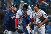 Pitcher Denyi Reyes (41) of the Greenville Drive, center, is congratulated after using just 92 pitches to post a nine-inning complete-game shutout against the Columbia Fireflies on Sunday, May 27, 2018, at Spirit Communications Park in Columbia, South Carolina. Greenville won, 3-0. It was the first complete-game shutout in the South Atlantic League this season.(Tom Priddy/Four Seam Images)