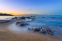 Blurred waves on Gigaro beach rocks during a colorful sunrise on the Mediterranean Sea and the islands, in gulf of Saint-Tropez, Azure coast France